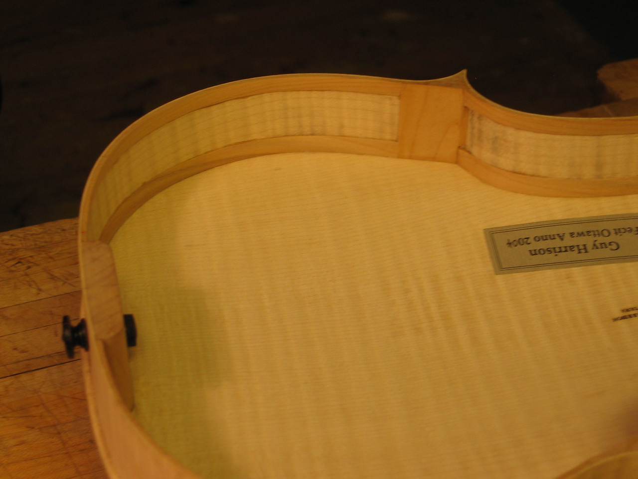 July 19 - Note the flange on the end button. This is used because in this small viola, the reinforcing block is smaller than usual to lengthen the inside of the instrument.