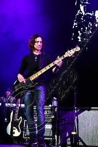 LOS ANGELES, CA - APRIL 19:  Bassist Juan Calleros  of Mana performs at Staples Center on April 19, 2012 in Los Angeles, California.  (Photo by Chelsea Lauren/WireImage)