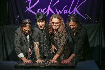 HOLLYWOOD, CA - SEPTEMBER 17:  (L-R) Guitarist Sergio Vallin, drummer Alex Gonzalez, vocalist Fher Olvera and bassist Juan Calleros of Mana are inducted into Guitar Center's RockWalk at Guitar Center on September 17, 2012 in Hollywood, California.  (Photo by Chelsea Lauren/WireImage)