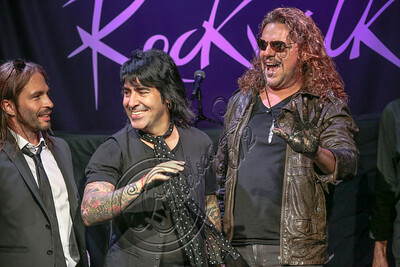 HOLLYWOOD, CA - SEPTEMBER 17:  (L-R) Guitarist Sergio Vallin, drummer Alex Gonzalez and vocalist Fher Olvera of Mana are inducted into Guitar Center's RockWalk at Guitar Center on September 17, 2012 in Hollywood, California.  (Photo by Chelsea Lauren/WireImage)