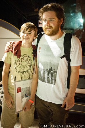 Andy Hull of Manchester Orchestra poses for a picture with a fan after the band's show on May 24, 2011 at The Ritz Ybor in Tampa, Florida