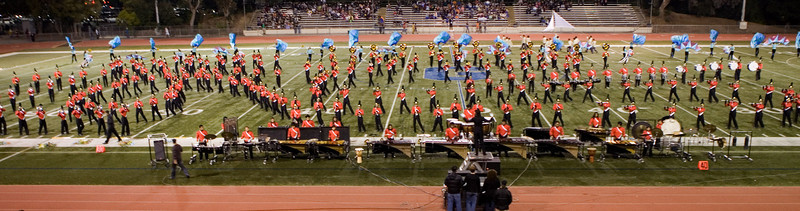 WOW, that's a BIG BAND!  Who are those 3 performers not wearing uniforms at the front?