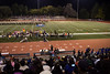 The Spartans take the field while the last of the Logan band works its way off the field.