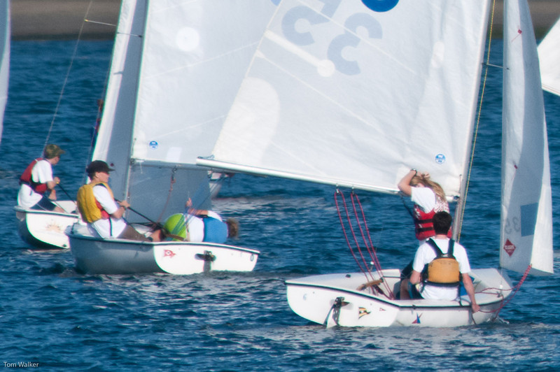 Thomas and Madie running downwind. Madie's holding the boom out to keep the sail full.