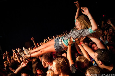 A fan body surfs across the crowd during Matt & Kim's sold-out show on October 15, 2010 at State Theatre in St. Petersburg, Florida.
