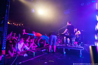 A fan (of Matt & Kim, as well as the Florida Gators) body surfs his way on stage during Matt & Kim's sold-out show on October 15, 2010 at State Theatre in St. Petersburg, Florida.