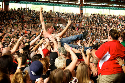 Crowd surfer at PNC Pavilion while Anthrax performs