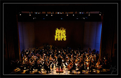 "Mighty Pops  Christopher Lees, music director, in his surprising Pops super-cape to conduct the encore, 'Mighty Mouse""  F2005 ""Animated Pops"" Concert Michigan Pops Orchestra  20-NOV-2005"