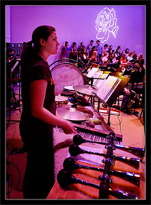 "Ashley McNees  Ashley, next to the ""American in Paris"" car horns and ready with her chimes for ""Beauty and the Beast""  Ashley McNees, percussion Michigan Pops Orchestra  01-APR-2007"