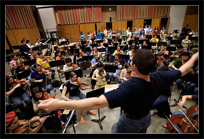 Sea of Players  John conducts the orchestra and chorus during a dress rehearsal at the School of Music  John Zastoupil, music director Michigan Pops Orchestra  27-MAR-2007