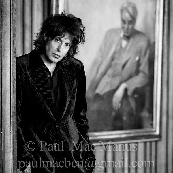 WBGL-51 Mike Scott of The Waterboys with a Portrait of W.B. Yeats. Abbey Theatre, Dublin, 2009