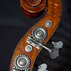 Double-bass scroll showing tuner keys, gears, and volute