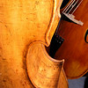 Old Wood - two double-basses;  the bass nearest to the camera is violin cornered, and its wood is old and full of character.