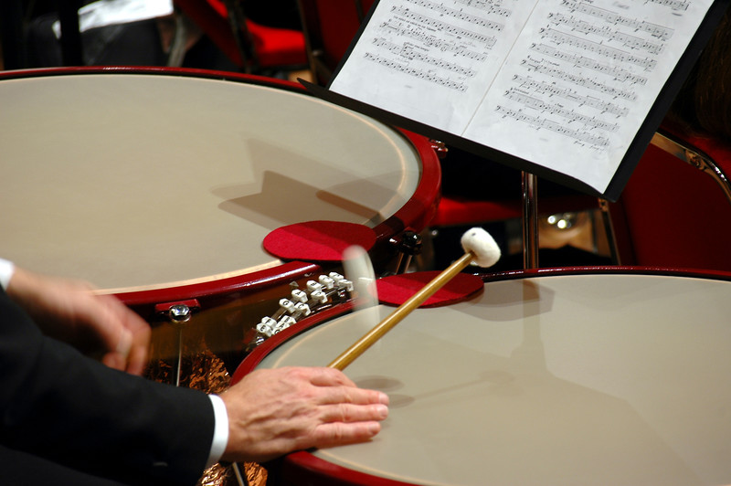 Timpani roll, showing timpanist's hands, mallets, tuning gauges and heads of timpani