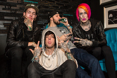 WEST HOLLYWOOD, CA - NOVEMBER 13:  (L-R) rapper T. Mills, Musician David Schmitt of Breathe Carolina, musician Kyle Even of Breathe Carolina and musician Jeffee Star pose backstage at The Roxy Theatre on November 13, 2012 in West Hollywood, California.  (Photo by Chelsea Lauren/WireImage)