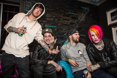 WEST HOLLYWOOD, CA - NOVEMBER 13:  (L-R) Musician David Schmitt of Breathe Carolina, rapper T. Mills, musician Kyle Even of Breathe Carolina and musician Jeffee Star pose backstage at The Roxy Theatre on November 13, 2012 in West Hollywood, California.  (Photo by Chelsea Lauren/WireImage)