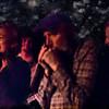 Close.<br /> Vocal Karina Turi, guitar Henrik Parkov, mouth organ Mogens Michelsen and bass Philip Farlie of Downtown Blues band at Mojo Blues bar, Copenhagen, Denmark.<br /> Photo painted with digital chalk brush in Corel painter.