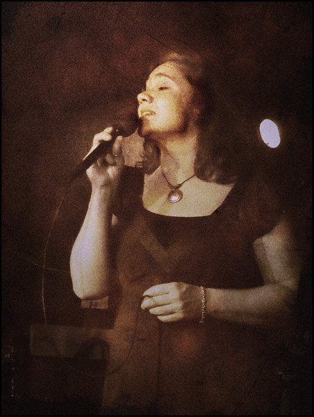Glamour Blues.<br /> Lea Thorlann, vocal at Mojo Blues Bar, Copenhagen.<br /> Photo turned sepia + texture.