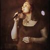 Glamour Blues.<br /> Lea Thorlann, vocal at Mojo Blues Bar, Copenhagen.<br /> Photo turned sepia + texture.