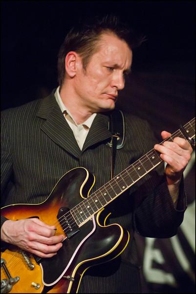 """Ronni Cash"" - color photo.<br /> Ronni Boysen: guitar at Mojo Blues Bar, Copenhagen.<br /> Digital color photo."