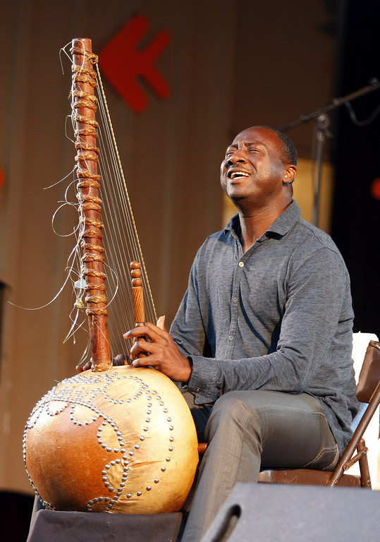 . Sekuo Kouyate plays the Kora with the Roberto Fonseca group on the Garden Stage during the 56th Monterey Jazz Festival at the Monterey Fairgrounds on Sept. 20, 2013.  (Vern Fisher/Monterey County Herald)