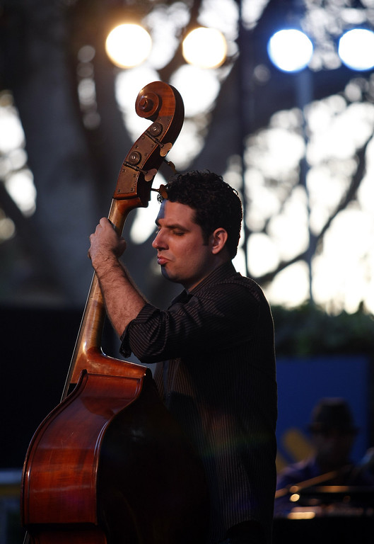 . Yandy Martinez plays bass with the Roberto Fonseca group on the Garden Stage during the 56th Monterey Jazz Festival at the Monterey Fairgrounds on Sept. 20, 2013.  (Vern Fisher/Monterey County Herald)