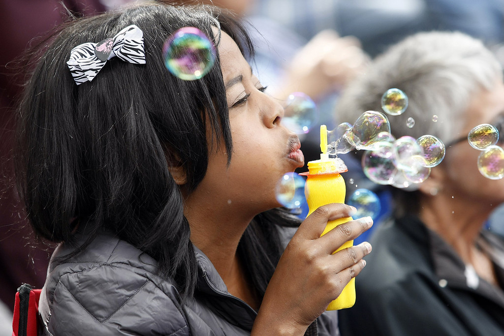 . Megan Terry from Monterey blows bubbles at the Garden Stage at the Monterey Jazz Festival on Sept. 21, 2013.  (Vern Fisher/Monterey County Herald)