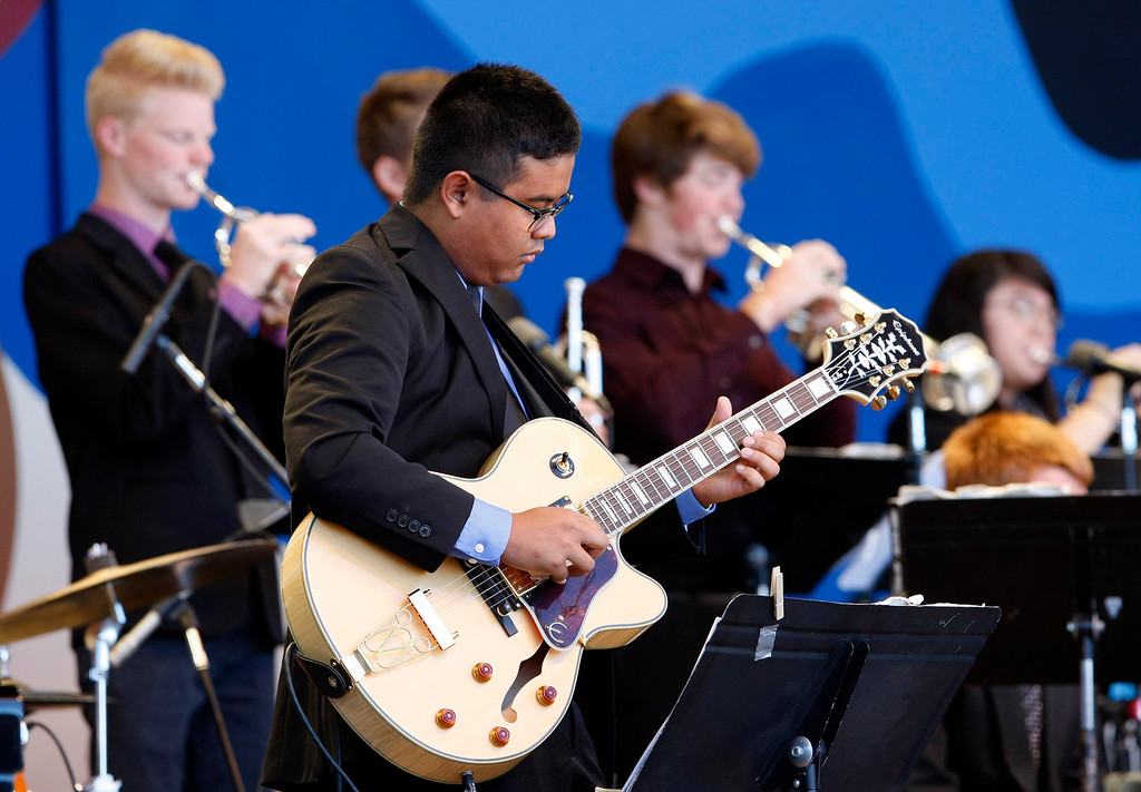 . Guitar play Micah Stevens with the Folsom High School Jazz Band performs at the Monterey Jazz Festival on Sept. 22, 2013.  (Vern Fisher/Monterey County Herald)
