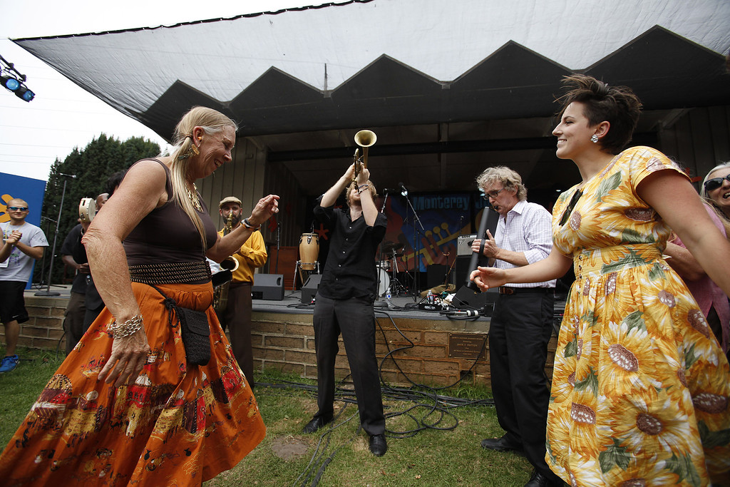 . Barbara Alaimo and Briggette Barnato dance to the tunes of the California Honeydrops with front man Lech Wierzynski on trumpet during their performance on the Garden Stage at the Monterey Jazz Festival on Sept. 21, 2013.  (Vern Fisher/Monterey County Herald)