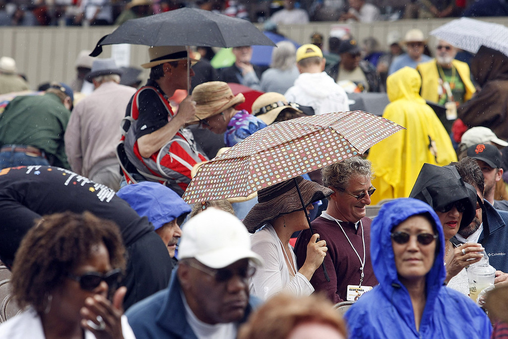 . Umbrellas came out for a time at the main arena at the Monterey Jazz Festival on Sept. 21, 2013.  (Vern Fisher/Monterey County Herald)