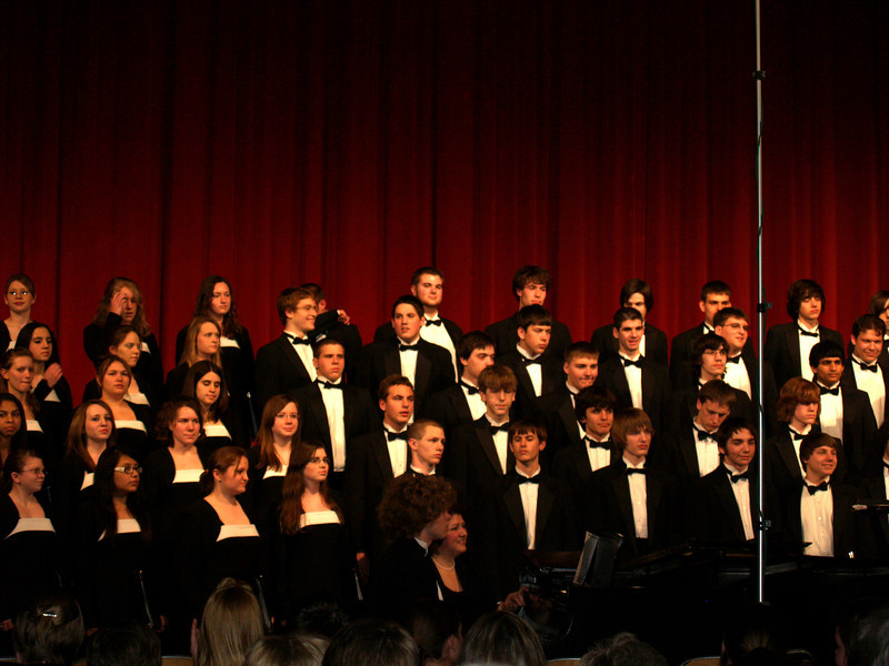 Seth Accompanying combined choirs at QCHS Spring Concert