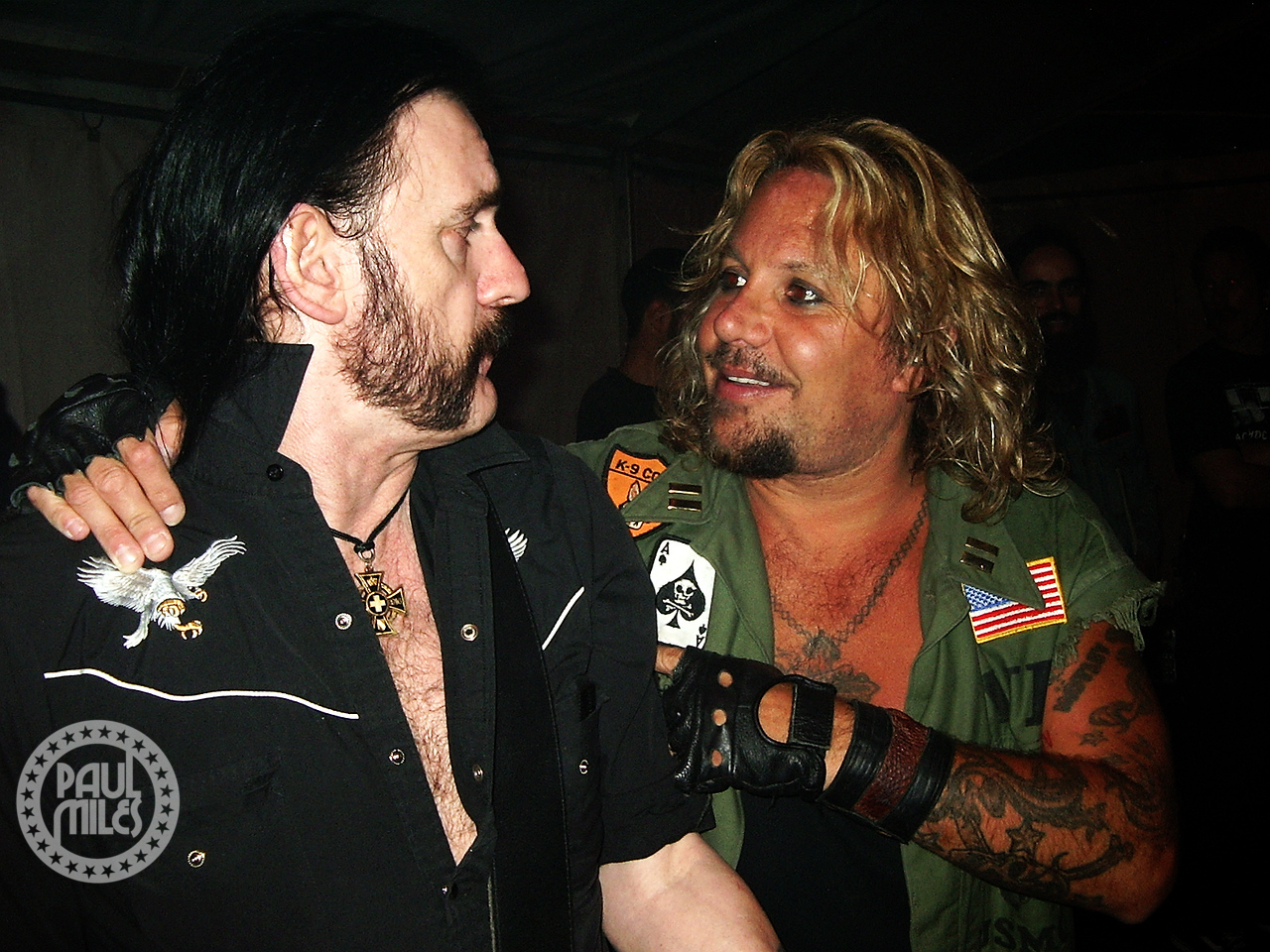 Vince Neil side of stage stepping Motorhead's Lemmy through the verse lyrics to Motley Crue's version of Anarchy In The USA, before they sing this encore song at Blackjack Festival on 10 December 2005 to complete their Australian Tour.