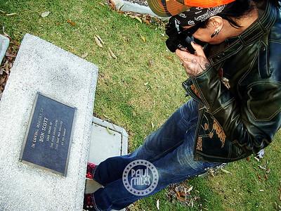 Avid photographer Nikki Sixx shooting the memorial seat of the late AC/DC singer Bon Scott on a visit to Fremantle Cemetery during Motley Crue's 2005 Australian Tour.