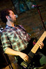 Jason Pomar provides lead volcals and bass for Sun Domnigo performing at the Evening Muse Dec 9th 2009
