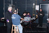 Sound engineers (Joe Kuhlman) and stage managers (Irwin Bostian) review the technical requirements of each performer prior to the beginning of the Tosco Music Party Jan 28th, 2012 at the Halton Theatre on the CPCC central campus.