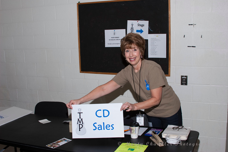 Volunteer Amy Royal supporting the artist marketing registration table at the Tosco Music Party Jan 28th, 2012 at the Halton Theatre on the CPCC central campus.