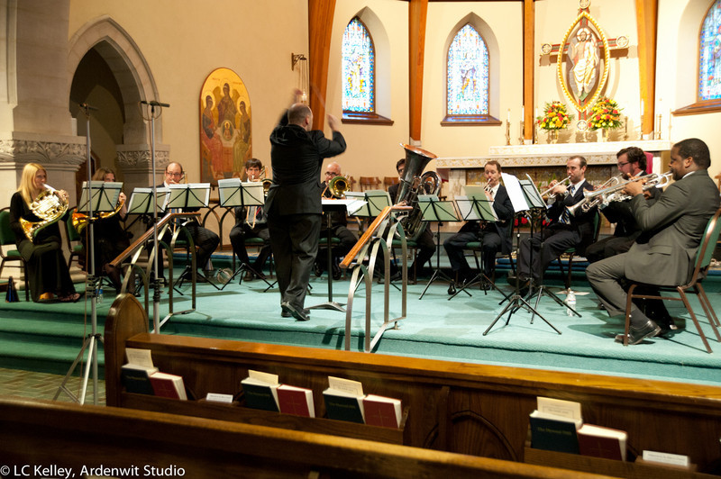 Philos Brass, with conductor Paul Bryan, and founder Stanford Thompson (right)