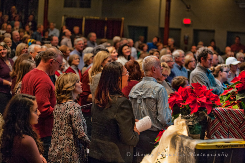 Attendees enjoying a sing-along  at the Tosco Music Holiday Party held in the McGlohon Theater at Spirit Square in Charlotte, NC, Dec10th 2016.