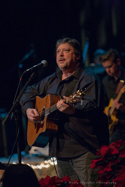 John Tosco leads the TMP Choir & Band during a sing-along at the Tosco Music Holiday Party held in the McGlohon Theater at Spirit Square in Charlotte, NC, Dec10th 2016.