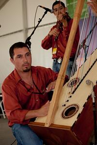 """Miguel Prado of Arpex, from Fresno, Calif., perform """"musica de arpe grande"""" (large harp music)."""
