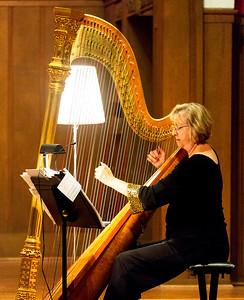 Paula Page playing her harp