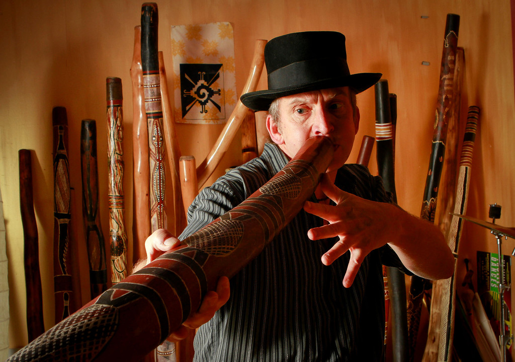 Stephen Kent plays his Didgeridoo at his home in Oakland , Calif., on Tuesday, December 20, 2011.