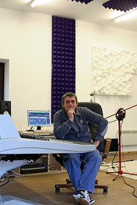 Legendary musician Mike Oldfield playing guitar at his private recording studio - watch his video interview on www.recordproduction.com