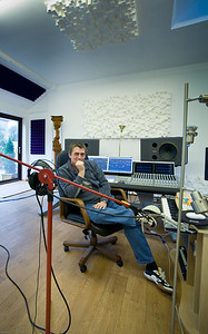 Mike Oldfield sits in his recording studio
