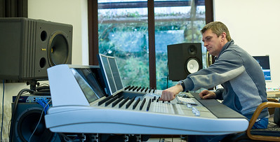 Mike Oldfield using his mixing desk in the recording studio