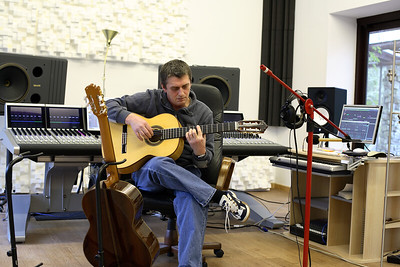 Legendary musician Mike Oldfield playing guitar at his private recording studio - watch his video interview on www.recordproduction.com PUBLISHED:  Resolution Magazine (Cover), UK