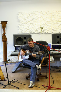 Mike Oldfield playing guitar in the recording studio