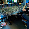 Mike Skinner sits behind his SSL Duality mixing console at his private recording studio, London, England