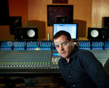 Mike Skinner (The Streets) at SSL behind Duality mixing console in a recording studio