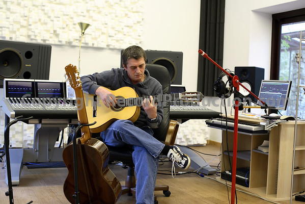 Mike Oldfield in the recording studio playing guitar